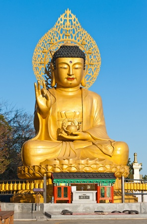Golden Buddha statue at buddhist temple of Sanbanggulsa at Sanbangsan of Jeju island Korea Stock Photo - 11033483