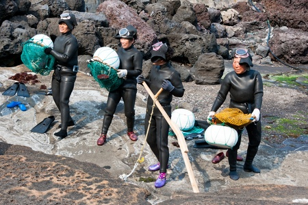 JEJU-DO - MARCH 27: Show of sea women -  Haenyo divers at Jeju-do of Korea, March 27, 2011,  Jeju, South Korea.