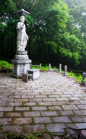garden statue of Buddha in the Sinheungsa Temple in Seoraksan National Park, South korea  photo