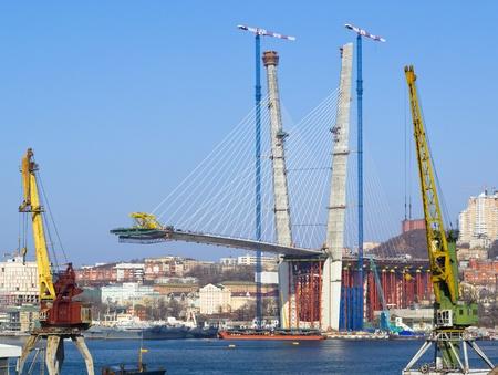 construction of big guyed bridge in the Russian Vladivostok over the Golden Horn bay Editorial