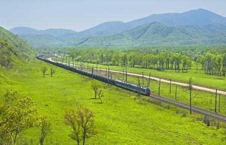 russian cargo train against the hills landscape  photo