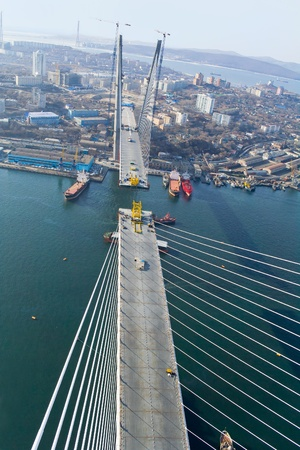 construction of big guyed bridge in the Russian Vladivostok over the Golden Horn bay photo
