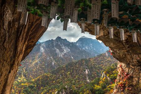 myst: Lungta, ritual wish flags at Buddhist monk cave for meditation at seorak mountains at the Seorak-san National Park, Soraksan, South korea