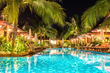 beach hotel: night view of beautiful swimming pool in tropical resort , Phuket, Thailand.