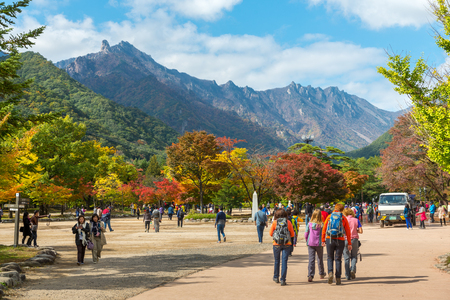 Seorak, Sokcho, South Korea - October 23, 2013: Tourists at the entrance of Seoraksan National Park, South korea