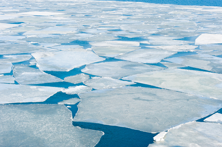 ocean water: breaking spring ice floe at the sea