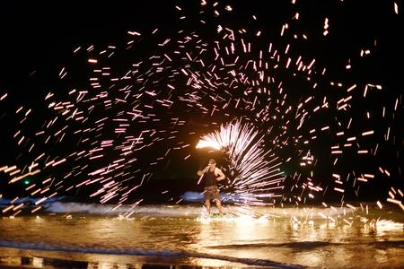 firestarter: unidentified Firestarter performing amazing fire show at Koh Samed Samet island Thailand
