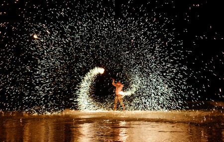 fire show: Firestarter performing amazing fire show at Koh Samed Samet island Thailand