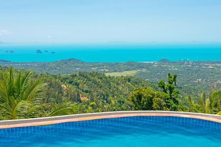 Paradise Farm Park swimming pool at Samui Thailand and panoramic view of island