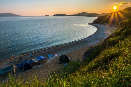 sunset camping view on the beach of russian isle Putyatin