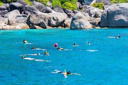 similan: Tourists snorkling at Similan Koh Similan No.8 Island in Similan national park, and discovering plenty of fishes and corals.