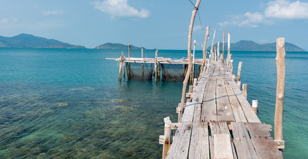 wooden mooring at the beach of the Koh Ku Dee, Thailand Stock Photo