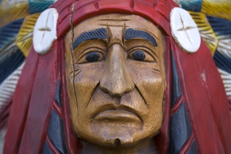 An old painted cigar store indian wood carving. photo