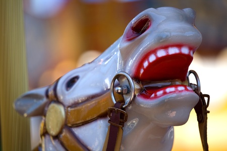 Detail of a painted carousel horse at the fair.