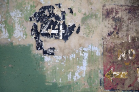 The number 4 on a wall with peeling paint.