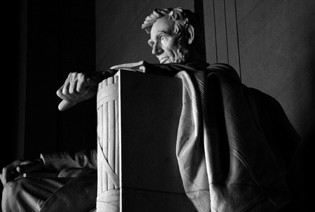 A black and white image of the 16th President of the United States Abraham Lincoln at the Lincoln Memorial in Washington, D C , USA
