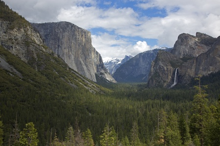 The famous Tunnel View at Yosemite National Park in California.  The View includes El Capitan on the left, Bridalveil Falls on the right and Half Dome in the background.
