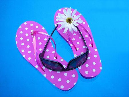dainty: flip-flops floating in pool