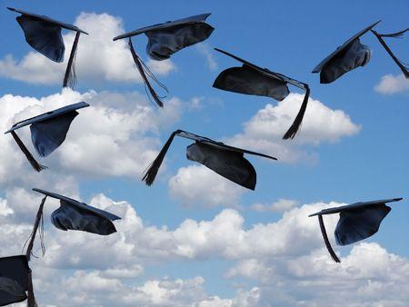 graduation caps: airborne graduation caps Stock Photo
