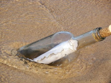 buried bottle in sand with message Stock Photo - 3101609