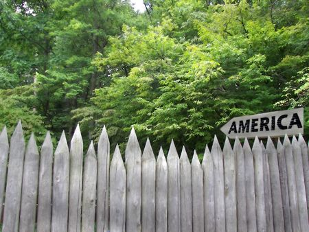american sign in woods with fence photo