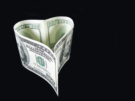 money folded in heart shape Imagens
