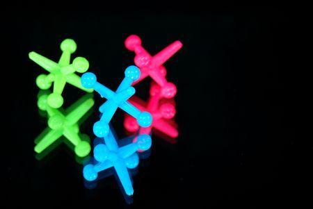 jacks: neon jacks reflected in mirror