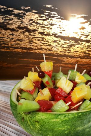 fruit: watermelon filled with fruit kabobs
