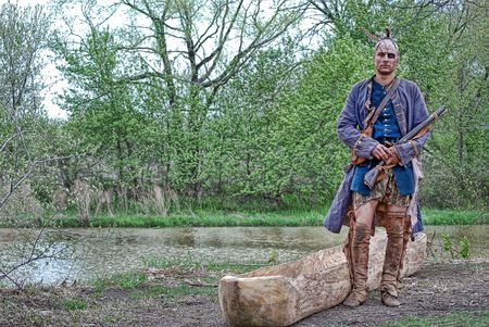 dugout: native american by his dugout canoe
