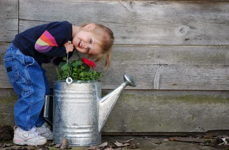 littlle girl with old watering can Stock Photo - 3170405