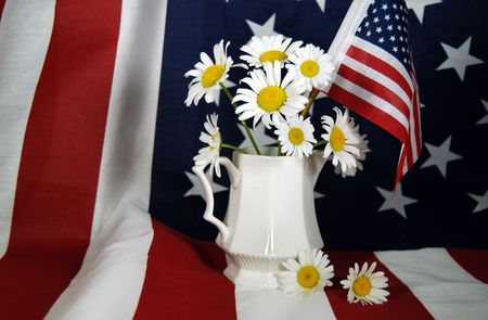 creamer: daisies in creamer pitcher on flag Stock Photo