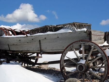 Old wagon in the winter snow. photo