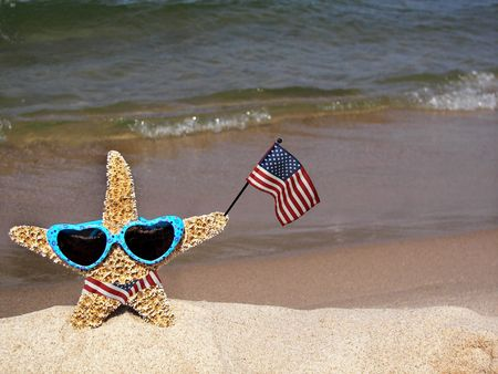 Starfish wearing a flag bikini on the beach.