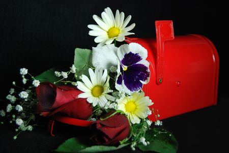 Red mailbox filled with flowers. photo