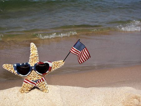 Patriotic starfish wearing a flag bikini and sunglasses.
