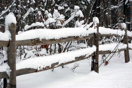 split rail: Snow on a split rail fence.