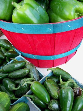 bushel: Green peppers in a red bushel basket.