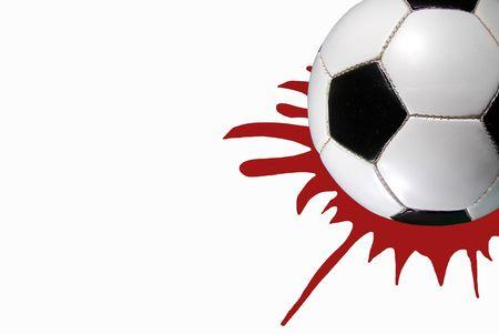 sheen: Soccer ball on red spot.