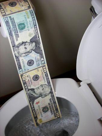화장실에서 플러시되는 돈.