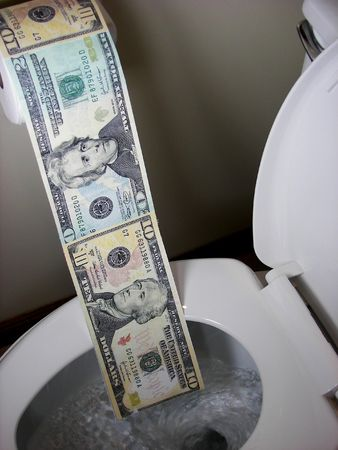 Money being flushed down a toilet.