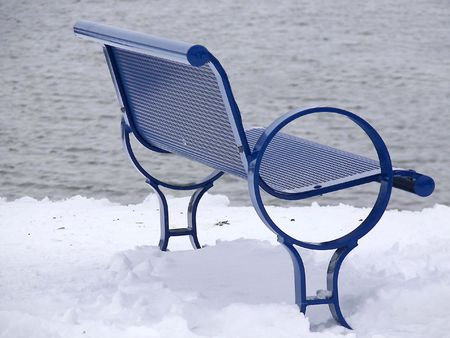 Blue bench in the snow.