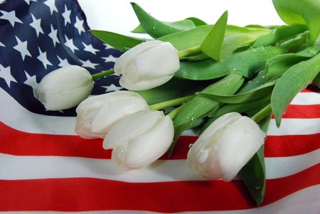 honorable: White tulips on a flag.