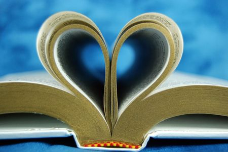 Pages of a Bible folded into a heart shape. Stock Photo - 3236898