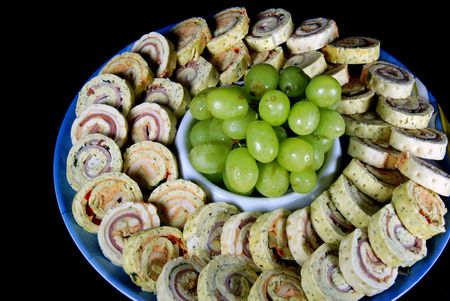Party plate of tasty appetizers.