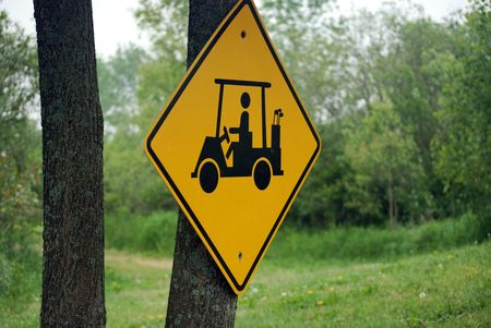 cart sign on tree trunk.