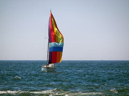 spinnaker: Colorful spinnaker on a sailboat.