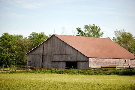 dilapidated: Dilapidated barn in the morning light.