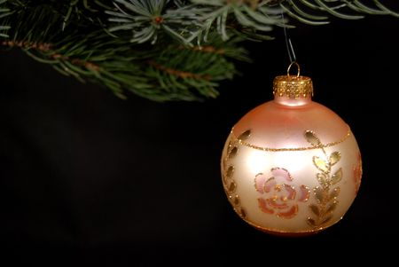 luster: Single Christmas ornament hanging from a bough.