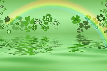 Rainbow and shamrocks reflected in water.