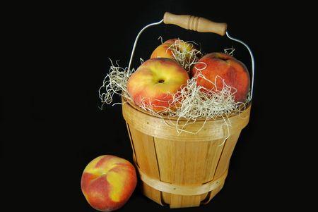 bushel: Peaches in bushel basket.